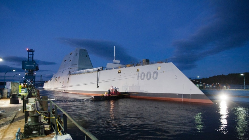 Oct. 28, 2013: In this image provided by the U.S. Navy the Zumwalt-class guided-missile destroyer DDG 1000 is floated out of dry dock at the General Dynamics Bath Iron Works shipyard.