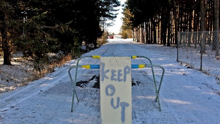 FILE - In this Nov. 26, 2012 file photo, a keep out sign stands at the property of Byron David Smith, in Little Falls, Minn. The Little Falls man who claimed he was defending his home from teens who had been terrorizing him for months goes on trial Monday, April 14, 2014, for their murders. (AP Photo/The Star Tribune, Elizabeth Flores)  MANDATORY CREDIT; ST. PAUL PIONEER PRESS OUT; MAGS OUT; TWIN CITIES TV OUT