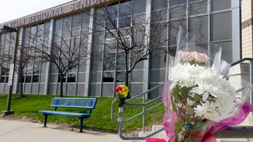 April 10, 2014: A bouquet of flowers is taped to a stairway rail near the entrance to Franklin Regional High School near Pittsburgh in Murrysville, Pa. A knife wielding student injured over 20 people in a stabbing attack there on April 9.