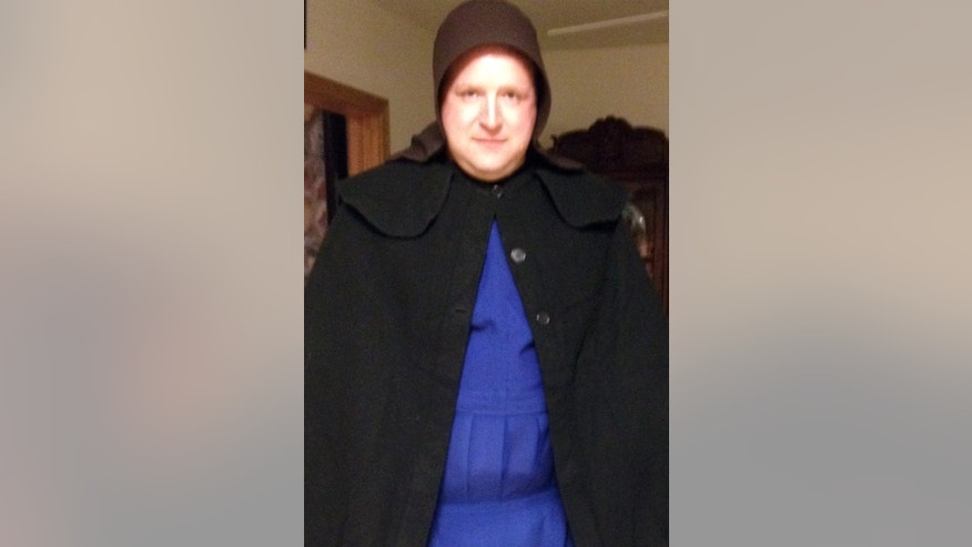In this undated photo provided by Sgt. Chad Adams of the Pulaski Township Police, Adams is seen dressed as an Amish woman. Adams, a male police officer, spent time on duty in December and January dressed as an Amish woman in hopes of scaring off a man suspected of exposing himself to Amish children in a western Pennsylvania township. The Amish did not want their children to testify in court and agreed to lend police the women's bonnets, aprons and dresses to catch or scare away the suspect. (AP Photo/Courtesy of Chad Adams)
