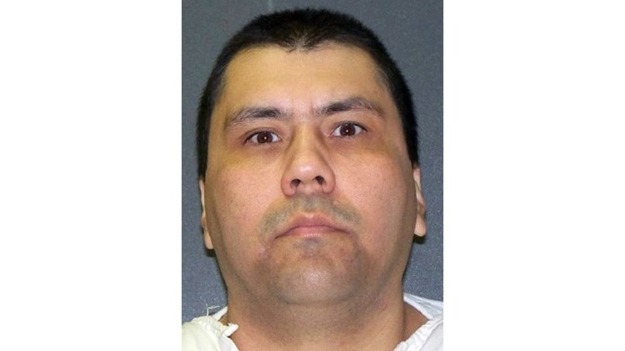 In this photo provided by the Texas Department of Criminal Justice is death row inmate Jose Villegas, 38, who was convicted of capital murder in the deaths of his ex-girlfriend, Erida Salazar, her 3-year-old son, Jacob, and her mother, Alma Perez, 51. (AP Photo/Texas Department of Criminal Justice)