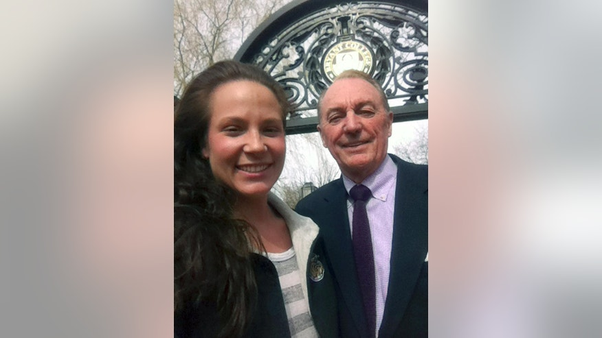 This photo taken and provided by Ali Luthman, left, of Worcester, Mass., shows her with Bryant University President Ronald Machtley on the school's campus in Smithfield, R.I. on Friday, April 18, 2104. Although Machtley, who is active on social media, loves posing for pictures with the students, the university has asked graduates to resist the urge to take a selfie with him when receiving their diploma this year, saying it will greatly prolong the graduation ceremony. Machtley says he is happy to take some after the service though. (AP Photo/Ali Luthman)