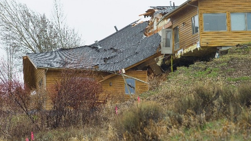 April 18. 2014: A house breaks apart as a slow-moving landslide in Jackson, Wyo. advances downhill.