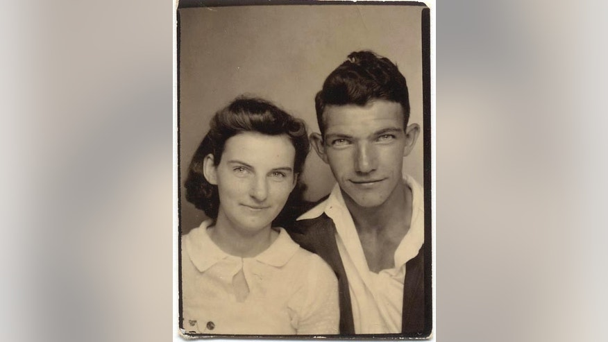 In this photo from the early 1940s provided by Dick Felumlee, Kenneth and Helen Felumlee of Nashport in central Ohio pose for a photo.
