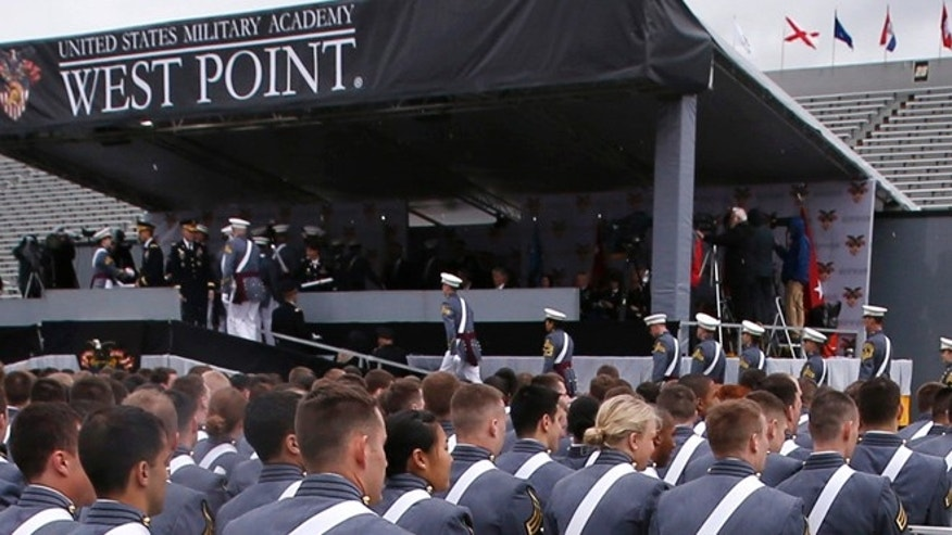 May 25, 2013: Cadets receive their graduation diplomas during ceremonies at the United States Military Academy at West Point, New York.
