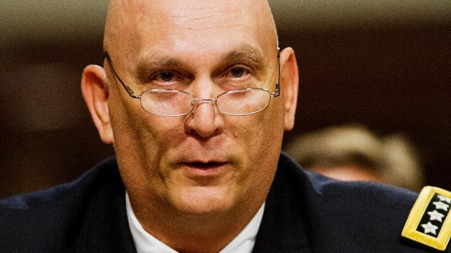 This Nov. 7, 2013 file photo shows Army Chief of Staff Gen. Raymond Odierno testifying on Capitol Hill in Washington. In the aftermath of the 9/11 attacks, young men and women joined the military to fight through the rugged mountains of Afghanistan and the dusty deserts of Iraq.  But now, as the wars wind down and Pentagon budgets shrink, many are being told they have to leave.