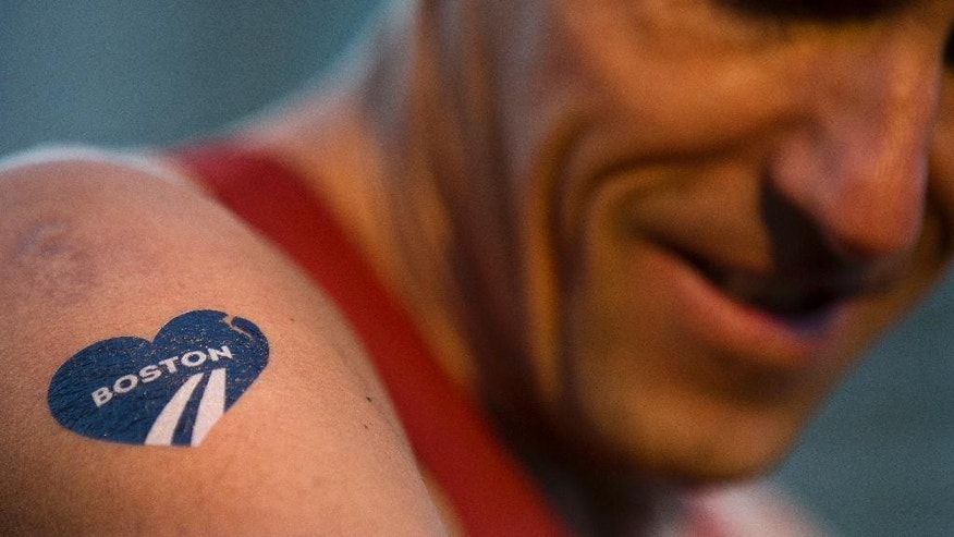 Till T. Teuber of Hamburg, Germany, prepares himself before the 118th Boston Marathon Monday, April 21, 2014 in Boston. (AP Photo/Matt Rourke)
