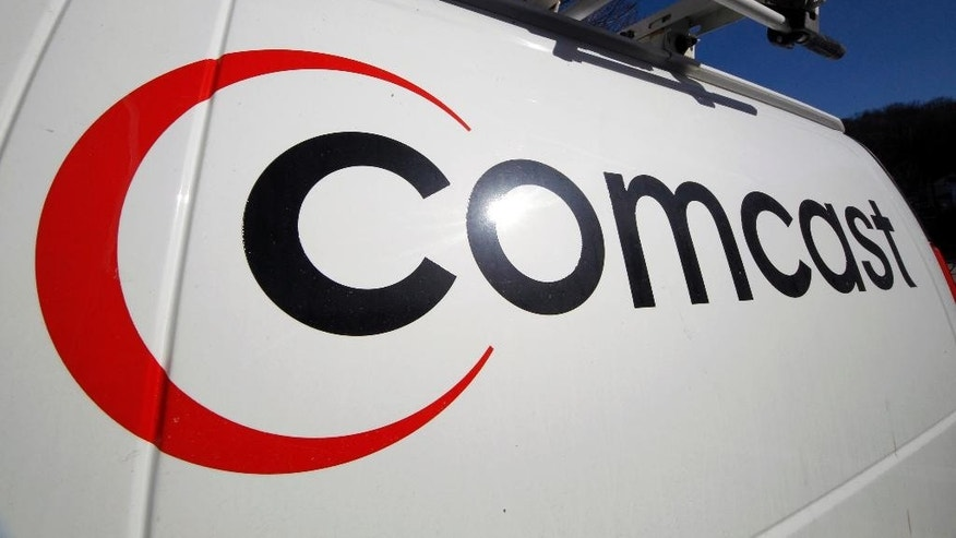 FILE - This Feb. 11, 2011 file photo shows the Comcast logo on one of the company's vehicles, in Pittsburgh. Comcast reports quarterly earnings on Tuesday, April 22, 2014. (AP Photo/Gene J. Puskar, File)