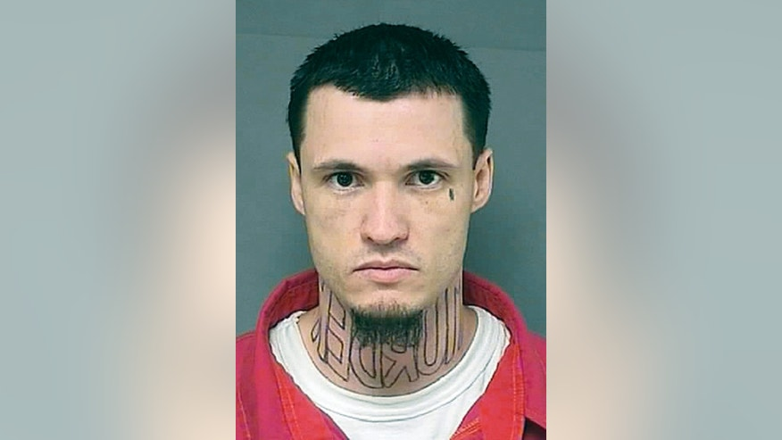 "This undated booking photo shows Jeffrey Chapman, charged with first-degree murder. Chapman is afraid the tattooed mirror-image letters spelling out the word ""murder"" across his neck might prejudice a jury, so he is asking for a professional tattoo artist to remove or cover it up. Prosecutors say they aren't opposed to Chapman covering his tattoo, but Barton County's sheriff says he's against transporting Chapman to a licensed tattoo facility — the only places tattoo artists are allowed to practice under Kansas law. The Great Bend Tribune reports Chapman's trial is scheduled to start Monday, April 28, 2014, in the November 2011 killing of Damon Galliart, whose body was found by hunters in a roadside ditch southwest of Great Bend. (AP Photo/The Great Bend Tribune)"