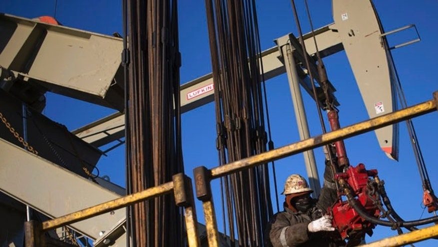 Mar. 12, 2013:A man works on the rig of an oil drilling pump site in McKenzie County outside of Williston, North Dakota. (Reuters)