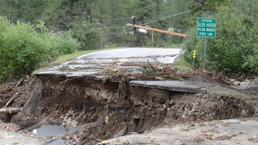 This image shows the destruction following a wall of rain water that washed out entire homes and roads in the tiny village of Glen Haven, Colo., during the statewide flooding in September that killed eight people.