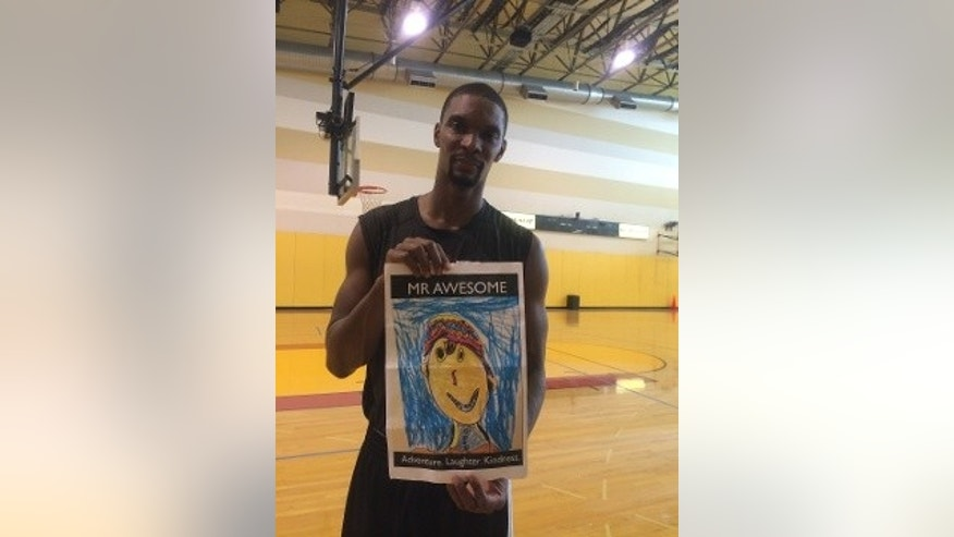 Miami Heat star Chris Bosh remembers Calder by taking a picture with the boy's self-portrait