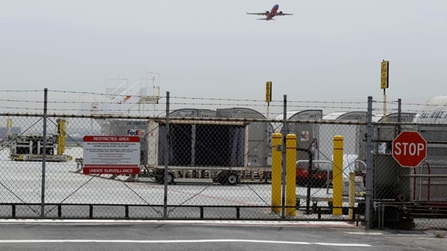 April 21, 2014: A plane takes off at Mineta San Jose International Airport in San Jose, Calif. A 15-year-old boy scrambled over a fence at the airport, crossed a tarmac and climbed into a jetliner's wheel well, then flew for five freezing hours to Hawaii, Sunday. FBI spokesman Tom Simon in Honolulu said the teen did not remember the flight from San Jose. (AP Photo/Eric Risberg)