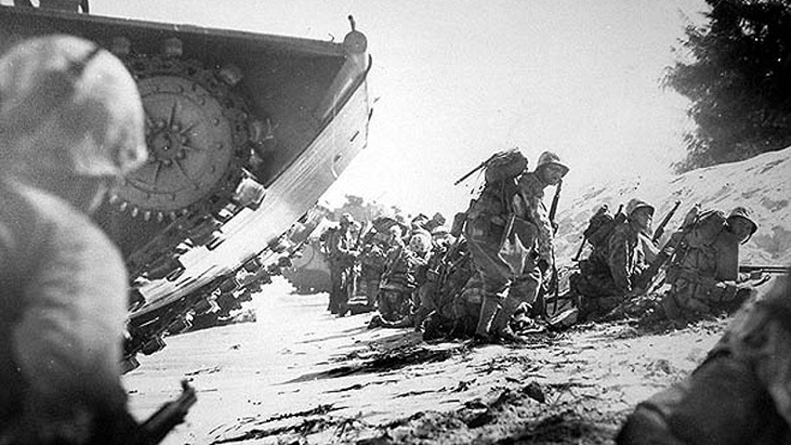 U.S. Marines land on Saipan Beach on June, 15 1944, when they attacked Japanese-held positions. Saipan is the largest island of the Northern Mariana Islands. (CNMI Historic Preservation Office)