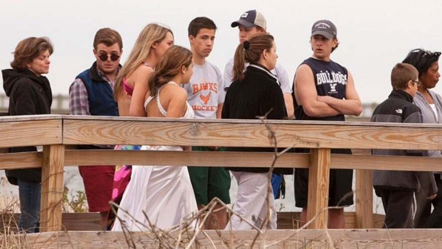 Apr. 25, 2014: Students arrive at the beach in their prom outfits for a vigil in honor of slain student Maren Sanchez in Milford, Connecticut.