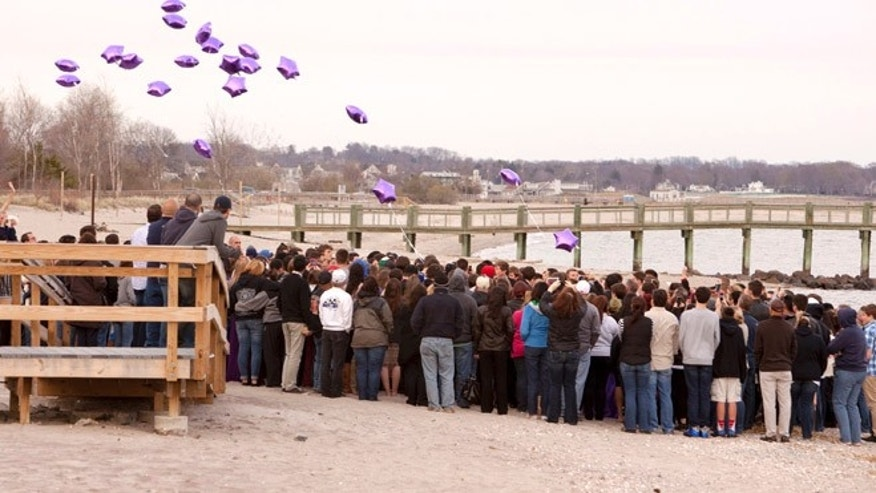 Apr. 25, 2014: Balloons are released at the beach during a vigil in honor of slain student Maren Sanchez in Milford, Connecticut.
