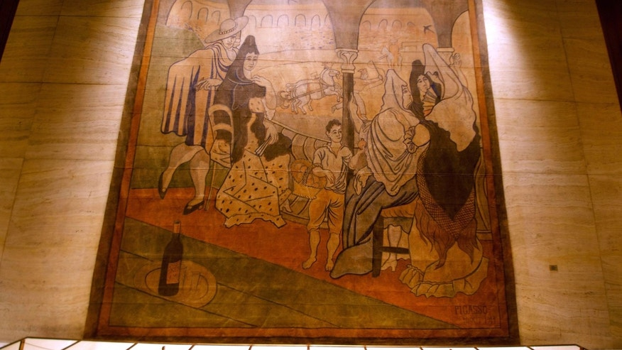 Feb. 28, 2014: In this photo provided by the New York Landmarks Conservancy, a stage curtain painted by Pablo Picasso hangs on a wall at the Four Seasons restaurant in New York.