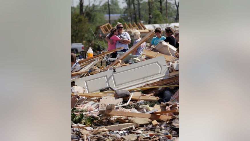 Residents and friends sift through debris after a tornado struck the area, Monday, April 28, 2014, in Vilonia, Ark. (AP Photo/Eric Gay)