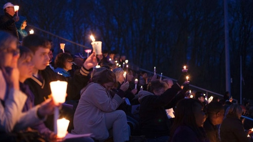 April 28, 2014: People gather at Jonathan Law High School during a vigil for slain student Maren Sanchez in Milford, Connecticut.