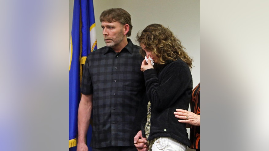 CORRECTS SPELLING TO HAILE - Jay and Jenny Kifer, right, the parents of Haile Kifer who was murdered, react during a news conference, Tuesday, April 29, 2014, after the homeowner Byron Smith was sentenced in Little Falls, Minn. Smith, who shot and killed Nick Brady, 17, and Haile, 18, during a 2012 Thanksgiving Day break-in, was convicted of premeditated murder. The jury took only about three hours to soundly reject his claim of self-defense. Smith was immediately sentenced to life without parole. (AP Photo/The Star Tribune, David Joles) MANDATORY CREDIT; ST. PAUL PIONEER PRESS OUT; MAGS OUT; TWIN CITIES TV OUT.