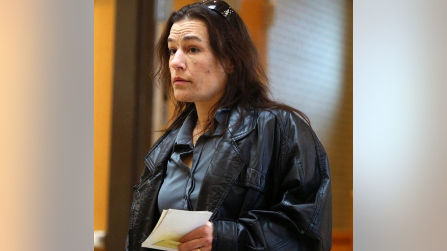 Kimberly Brady, mother of Nick Brady, arrives at the murder trial of Byron Smith at Morrison County Courthouse, Tuesday, April 29, 2014, in Little Falls, Minn. Smith, a Minnesota homeowner shot and killed Nick, 17, and Haile Kiefer, 18, during a 2012 Thanksgiving Day break-in, was convicted of premeditated murder. The jury took only about three hours to reject his claim of self-defense. He was immediately sentenced to life without parole. Smith was immediately sentenced to life without parole. (AP Photo/The Star Tribune, David Joles) MANDATORY CREDIT; ST. PAUL PIONEER PRESS OUT; MAGS OUT; TWIN CITIES TV OUT.