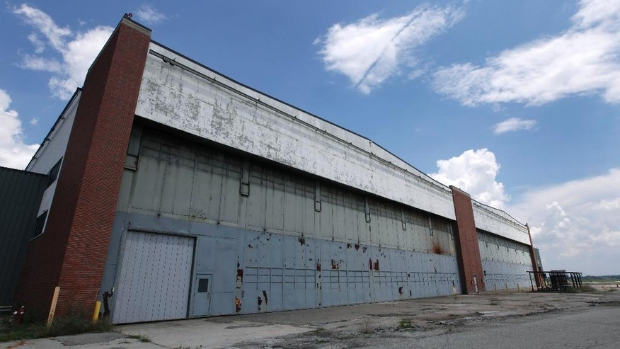 In this July 17, 2013, file photo, part of the former Willow Run Bomber Plant stands in Ypsilanti Township, Mich. A group wants to preserve a portion of the plant and house a museum there dedicated to aviation and the countless Rosies across the country. Save the Bomber Plant officials have until Thursday, May 1, to raise the remainder of the $8 million needed to save the plant from demolition. (AP Photo/Paul Sancya, File)