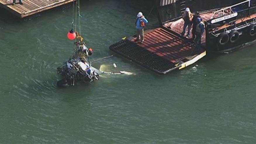 April 30, 2014: This image provided by KTVU-TV shows search efforts revealing part of a plane in the San Francisco Bay in San Francisco. Searchers on Monday located the Cessna under 13 feet of water about 1 1/2 miles off the Richmond shoreline east of San Francisco. (AP Photo/KTVU)