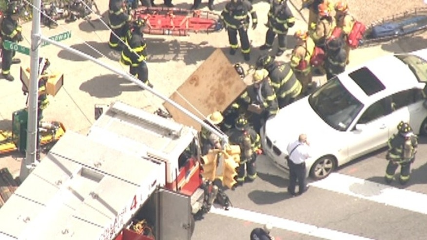 Emergency crews responded to a train derailment in Queens, New York.