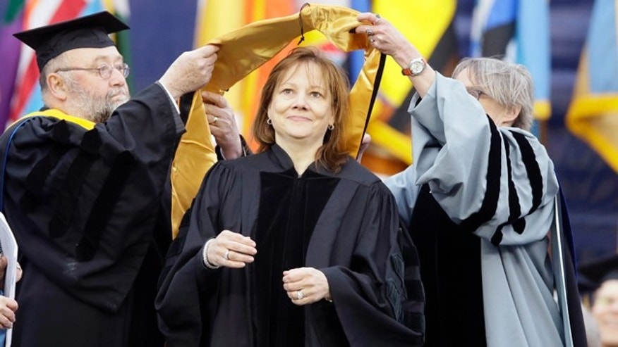 May 3, 2014: General Motors CEO Mary Barra, center, is conferred an honorary Doctor of Engineering degree before addressing the University of Michigan graduates at a commencement ceremony. (AP Photo/Carlos Osorio)