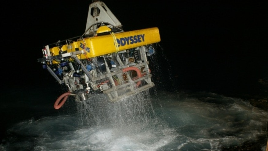 By using advanced robotics to explore deep-ocean sites, the Odyssey crew is able to work around the clock with limitless bottom time. Above, Odyssey's remotely operated vehicle returns to the surface following work on a deep-ocean shipwreck site. (Courtesy: Odyssey Marine Exploration, Inc.)