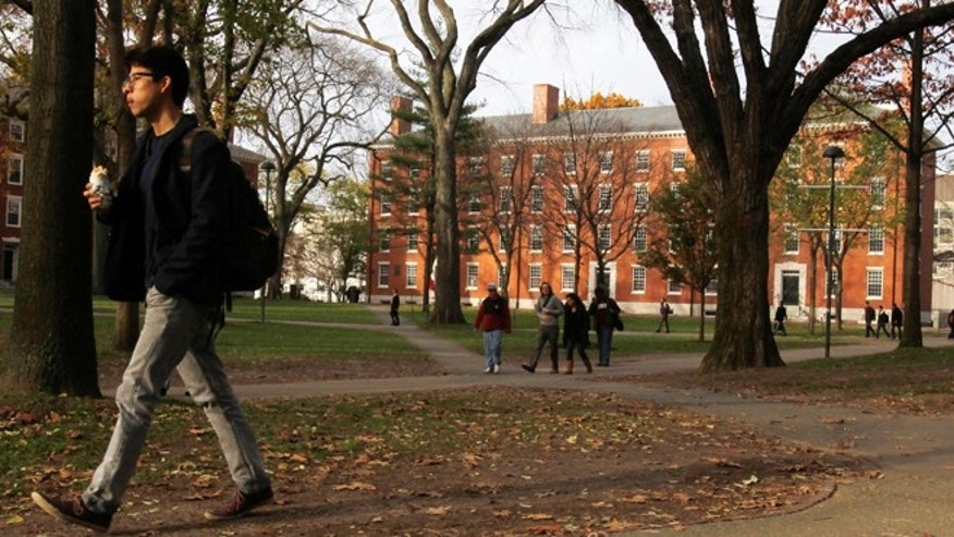 FILE 2012: A man walks through Harvard Yard at Harvard University. A recent survey suggests that getting into an elite school may not produce happier people.