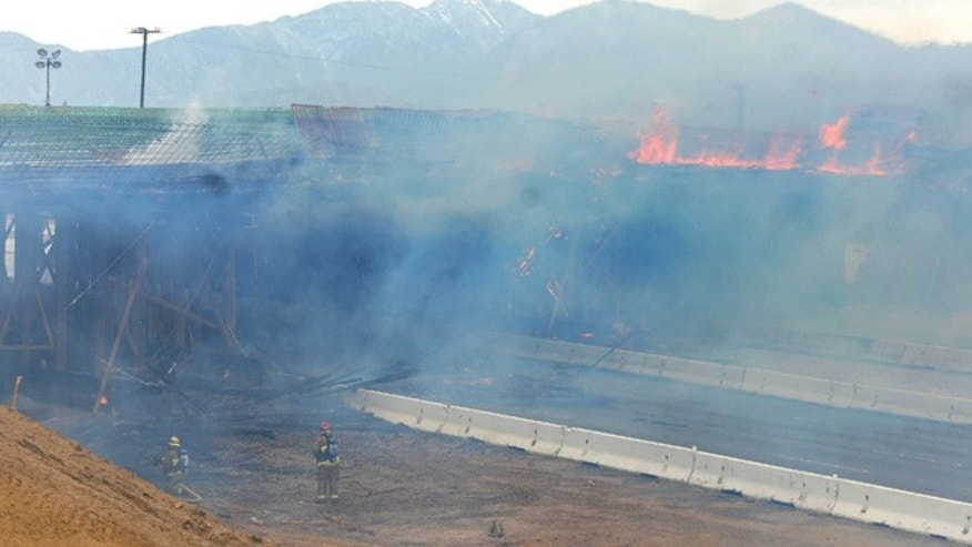 May 5, 2014: The construction site at Interstate 15 was engulfed in flames on in Hesperia, Calif. The California Highway Patrol's Carlos Juarez says the bridge at Ranchero Road caught fire at about 1:30 p.m. and Interstate 15 was closed soon after because of falling debris. (AP Photo/The Victor Valley Daily Press, David Pardo)