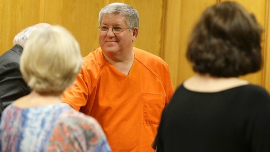 May 6, 2014: Bernie Tiede smiles after a court hearing granting his release at the Panola County court house in Carthage, Texas.  The former mortician whose killing of a rich widow shook an East Texas town and later inspired a movie will soon go free, after the district attorney who prosecuted him agreed Tuesday to let him out of a life sentence. (AP Photo/LM Otero)