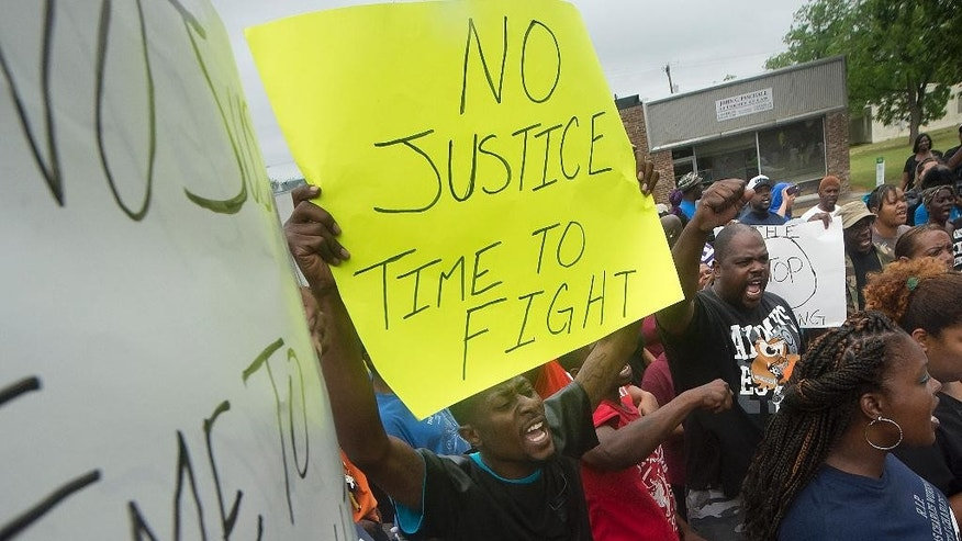 "Protesters chant during a rally outside the Hearne, Texas police department Thursday, May 8, 2014, following the Tuesday shooting of 93-year-old woman. Robertson County District Attorney Coty Siegert said Pearlie Golden was shot Tuesday night by Officer Stephen Stem. Stem was responding to a 911 call about a disturbance involving a woman with a gun. The Hearne Police Department says Golden ""brandished a firearm"" when Stem encountered her. He then shot her multiple times. The investigation into the shooting is being handled by the Texas Rangers.  (AP Photo/Bryan College Station Eagle, Stuart Villanueva)"