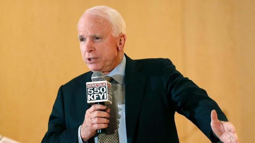 Sen. John McCain speaks during a forum with veterans on Friday, May 9, 2014, in Phoenix. McCain was discussing lapses in care at the Phoenix Veterans Affairs hospital that prompted a national review of operations around the country. (AP Photo/Matt York)