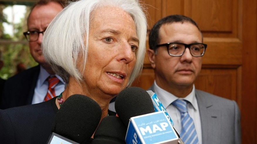 May 8, 2014: IMF Managing Director Christine Lagarde speaks with media as Moroccan Minister of Finance Mohamed Boussaid, right, looks on after a meeting at the Ministry of Finance in Rabat.