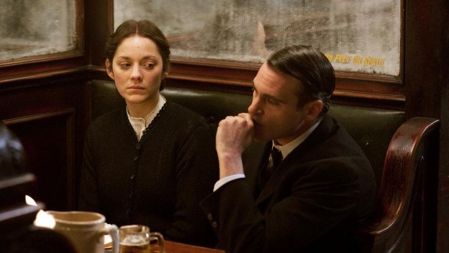 "This image released by The Weinstein Company shows Marion Cotillard, left, and Joaquin Phoenix in a scene from ""The Immigrant."" (AP Photo/The Weinstein Company, Anne Joyce)"