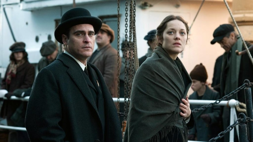 "This image released by The Weinstein Company shows Joaquin Phoenix, left, and Marion Cotillard in a scene from ""The Immigrant."" (AP Photo/The Weinstein Company, Anne Joyce)"