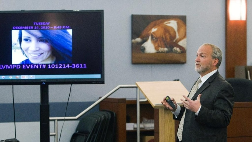 "Prosecutor Marc DiGiacomo gives opening statements during the trial for Jason Omar Griffith at the Regional Justice Center Thursday, May 8, 2014, in Las Vegas . Griffith is accused of murdering Luxor ""Fantasy"" dancer Deborah Flores Narvaez in December 2010. A photo of Narvaez is displayed on the video monitor.  (AP Photo/The Las Vegas Sun, Steve Marcus) LAS VEGAS REVIEW-JOURNAL OUT"