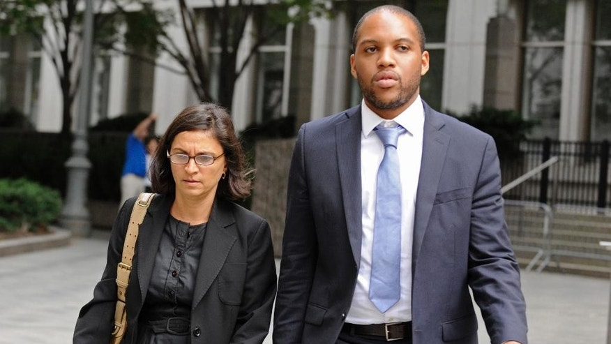 "FILE - In this Oct. 6, 2012, file photo, federal defense attorneys Sabrina Shroff, left, and Jerrod Thompson Hicks exit Manhattan federal court, in New York where they were representing Mustafa Kamel Mustafa, charged with conspiring to set up a terrorist training camp in Oregon and of helping abduct 16 hostages, two of them American tourists, in Yemen in 1998. It can be an uncomfortable life for any defense attorney representing unpopular clients, but lawyers who agree to speak on behalf of people accused of plotting to kill Americans in terrorist attacks walk difficult road. But representing every client, regardless of the crime, is the ""very essence of being a federal defender,"" said Shroff, an assistant federal defender. (AP Photo/ Louis Lanzano, File)"