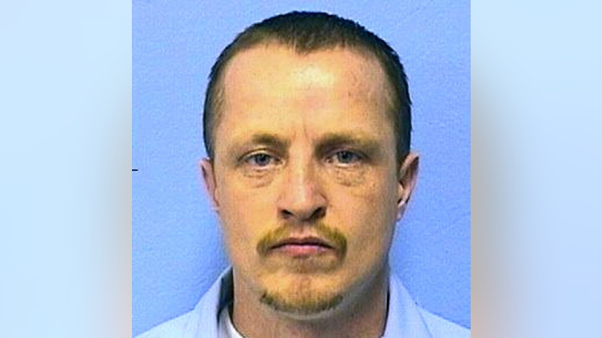 This undated photo provided by the Illinois Department of Corrections shows Nicholas Sheley. Jury selection began Monday, May 12, 2014, in Rock Island, Ill., for Sheley who is charged in four killings in 2008 in Rock Falls, Ill., that police say were part of a two-state killing spree. Sheley, who is 34, has pleaded not guilty. He is already serving two life terms after being convicted of killing one man in Sterling and another in Galesburg. He is also is charged in the deaths of an Arkansas couple who were killed in Festus, Mo.  (AP Photo/Illinois Department of Corrections)