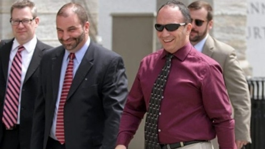 Former Scott Twp. Police Chief James Romano, right, leaves the Lackawanna County Courthouse on Monday.