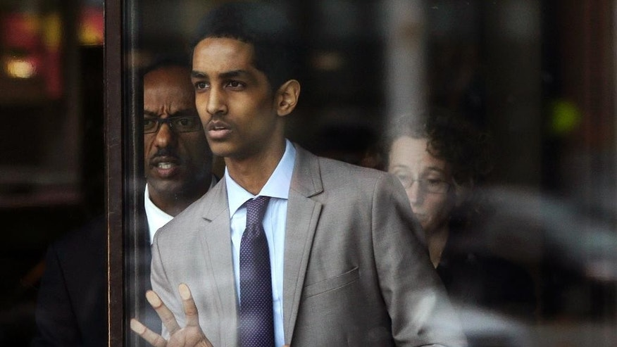 Robel Phillipos, a college friend of Boston Marathon bombing suspect Dzhokhar Tsarnaev, leaves federal court after a hearing Tuesday, May 13, 2014, in Boston. Phillipos, of Cambridge, Mass., is charged with lying to investigators after last year's fatal bombing. Judge Douglas Woodlock ruled Tuesday that separate trials will be held for Phillipos and two other of Tsarnaev's friends, Azamat Tazhayakov and Dias Kadyrbayev, but that their trials do not need to be moved out of Massachusetts. (AP Photo/Stephan Savoia)