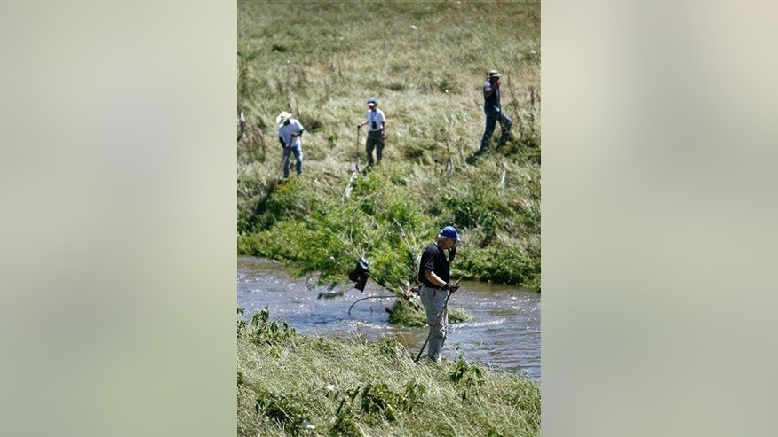Members of Texas Equusearch along the banks of Greens Bayou in Houston looking for a child killed in a car accident in 2009.