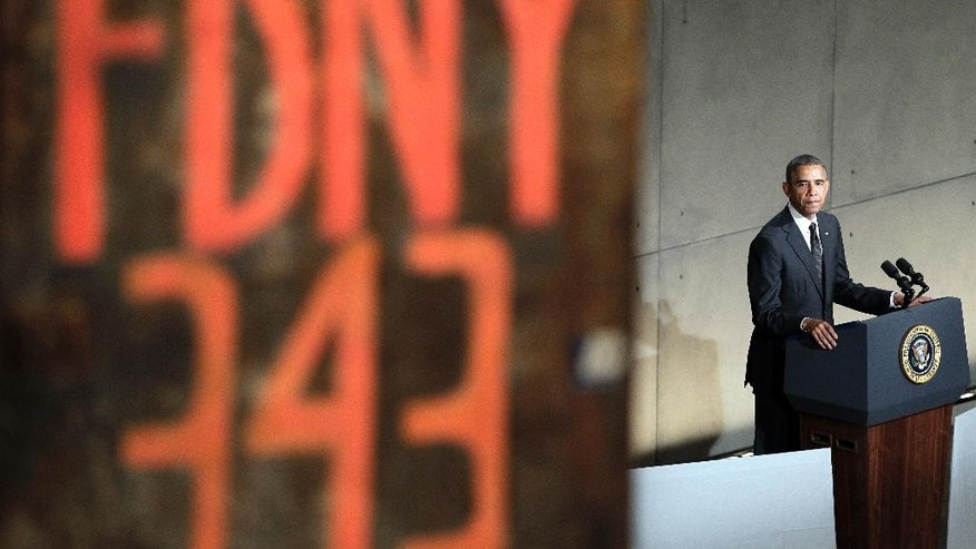 President Barack Obama speaks at the dedication ceremony for the National September 11 Memorial Museum on Thursday, May 15, 2014 in New York. The museum opens to the public on May 21. (AP Photo/John Angelillo, Pool)