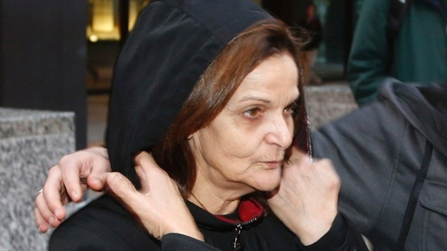 October 22, 2013: Rasmieh Yousef Odeh departs the federal courthouse after her initial appearance before U.S. Magistrate Judge Michael Mason in Chicago. (AP Photo/Charles Rex Arbogast, File)