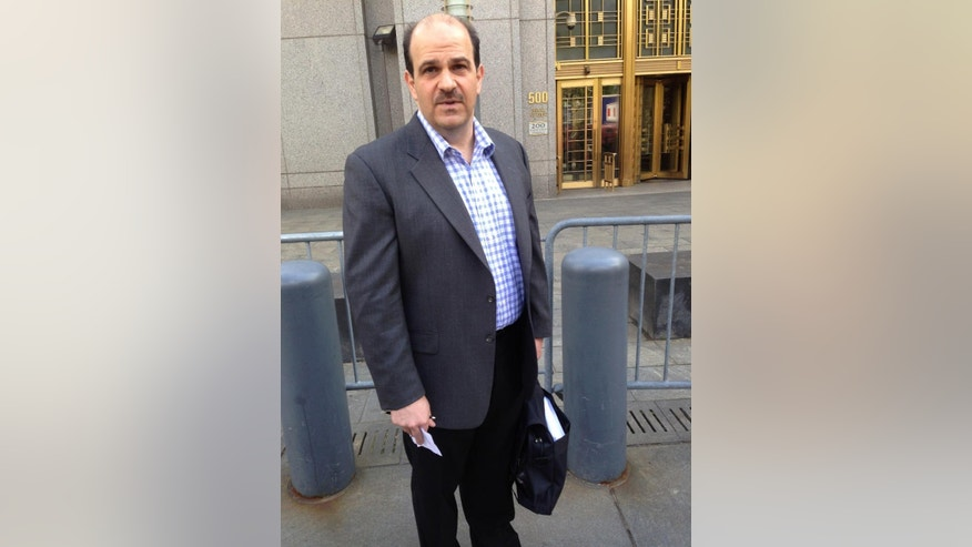 "Howard Bailynson, 44, jury foreman in the trial of  Mustafa Kamel Mustafa, makes a statement outside of Manhattan federal court in New York after the Egyptian Islamic preacher was found guilty Monday, May 19, 2014. i  Bailynson said Mary Quin, one of the two women held hostage, who also testified, was a ""great woman"" for having the courage to confront Mustafa with a tape recorder.  ( AP Photo/Larry Neumeister)"