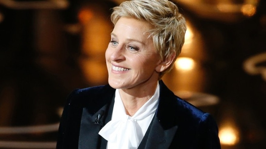 The principal of a Catholic elementary school in suburban Philadelphia is apologizing to parents for using a photo of Ellen DeGeneres, whom he called a 'poor role model.'