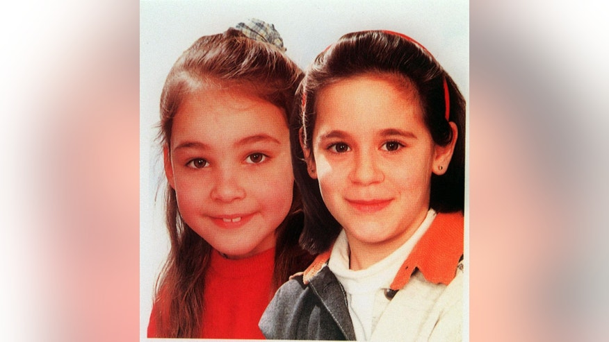 File-This 1996 file photo shows  Melissa Russo, left, and Julie Lejeune on a poster. Russo and Lejeune, where amonth the six girls, between ages 8 and 19 that snatched between mid-1995 and August 1996. The six victims were abducted, tortured and abused by Belgian Marc Dutroux.  He is serving a life sentence. His wife, Michelle Martin, is now in a convent after serving 16 years of a 30-year prison term. (AP Photo/File)