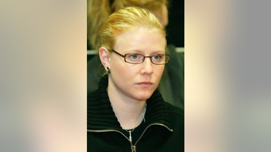 File-This March 10, 2004, file photo shows  Laetitia Delhez attending the hearing at the Palace of Justice in Arlon, Belgium. Girls between  the ages of 8 and 19 when snatched between mid-1995 and August 1996, the six victims were abducted, tortured and abused by Belgian Marc Dutroux. Only Sabine Dardenne, 12, and Delhez, 14, escaped alive after being found near the southern Belgian town of Charleroi a few days after Dutroux's arrest in August 1996. He is serving a life sentence. His wife, Michelle Martin, is now in a convent after serving 16 years of a 30-year prison term. (AP Photo/Jean-Michel Clajot, Pool,File)